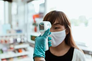 woman-wearing-a-face-mask-getting-her-temperature-checked-4429561